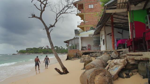 vídeos de stock, filmes e b-roll de ms view of damaged buildings on beach by 2004 asian tsunami at unawatuna / unawatuna, southern province, sri lanka - 2004
