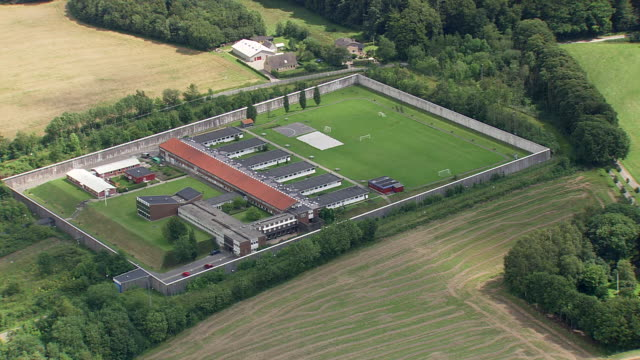 stockvideo's en b-roll-footage met ws aerial ds zo view of danish prison / fyn, denmark - gevangenis