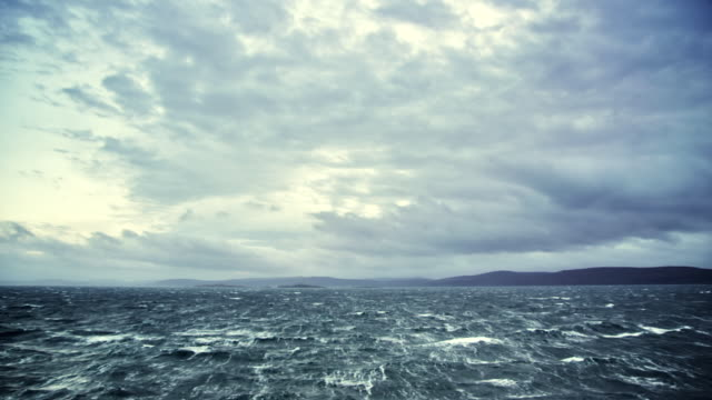 WS View of dark ocean waters with cloudy sky / Uig to Tarbert Ferry, Scotland, United Kingdom