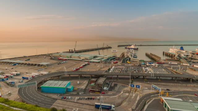 WS T/L View of dawn at port of Dover with passenger ferries and road transport / Dover, Kent, United Kingdom