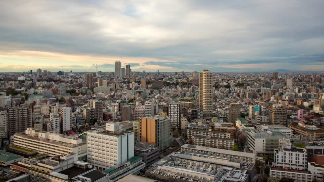 WS T/L View of day to night transition over Ikebukuro district / Tokyo, Japan