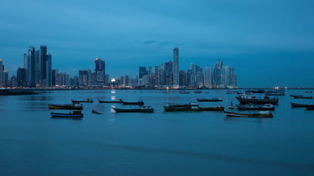 WS T/L View of day to night transition over panama city skyline and harbor / Panama