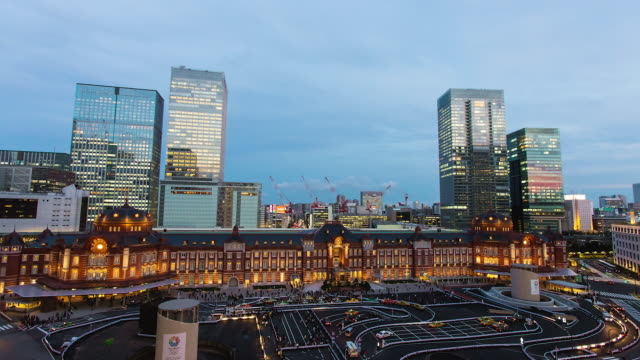 WS T/L View of day to night transition over recently refurbished Tokyo station at night / Tokyo, Japan