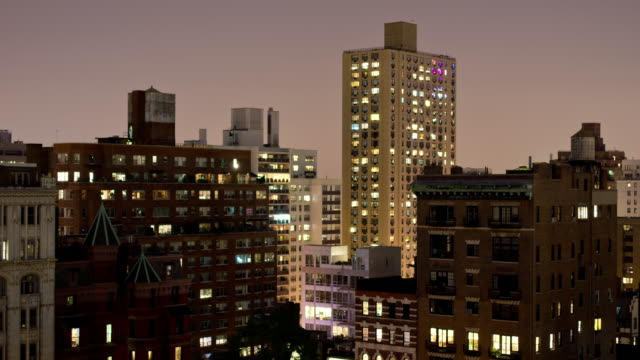 WS T/L  View of Day to night view with old new apartment buildings near Gramacy Park with apartment lights flickering / New York, United States