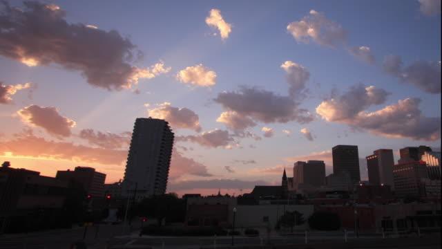 WS T/L View of daybreak and sunrise over cityscape / Oklahoma City, Oklahoma, USA