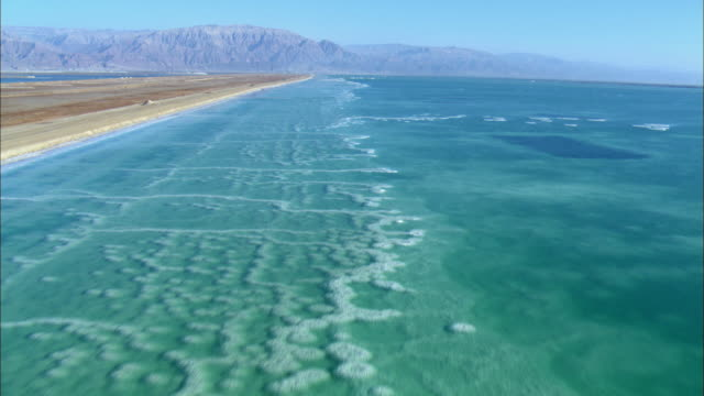 ws aerial view of dead sea salt formations / sourn judea desert, israel   - dead sea stock videos and b-roll footage