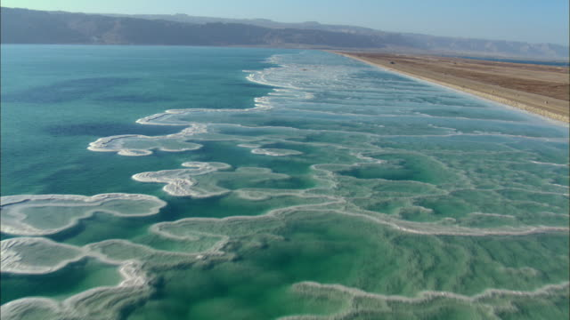 aerial ts ws view of dead sea salt formations / sourn judea desert, israel   - dead sea stock videos and b-roll footage