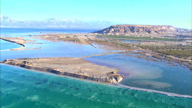 aerial zi ws pan view of dead sea salt formations / sourn judea desert, israel  - dead sea stock videos and b-roll footage