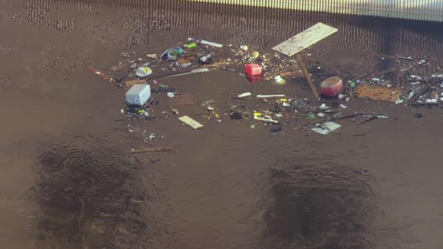 vídeos de stock, filmes e b-roll de view of debris circling near drainage water / united states - drenagem