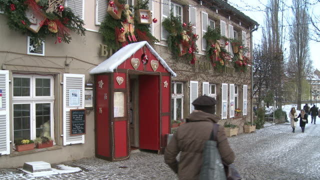 ws view of decorating restaurant at christmas / strasbourg, alsace, france - strasbourg stock videos and b-roll footage