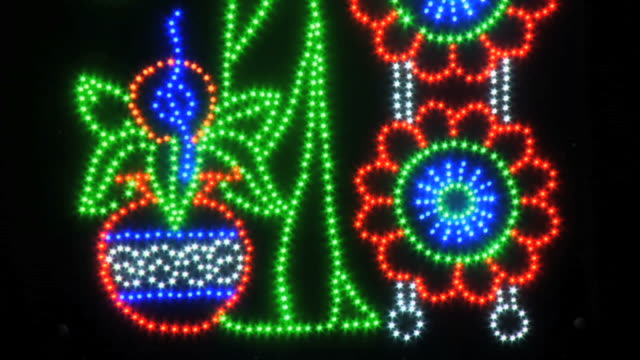 cu view of decorative lights on krishna janmashtami, huda gymkhana club, sector 29 / gurgaon, haryana, india - haryana stock-videos und b-roll-filmmaterial