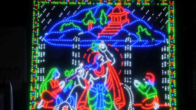 vídeos y material grabado en eventos de stock de cu view of decorative lights on krishna janmashtami, huda gymkhana club, sector 29 / gurgaon, haryana, india - krishna