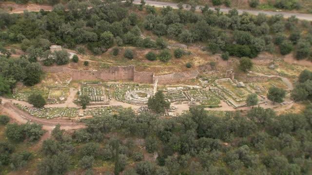 ws aerial zi view of delfi, delphi archaeological site, tholos base of mount parnassus / delphi, sterea ellada, greece  - mythology stock videos & royalty-free footage