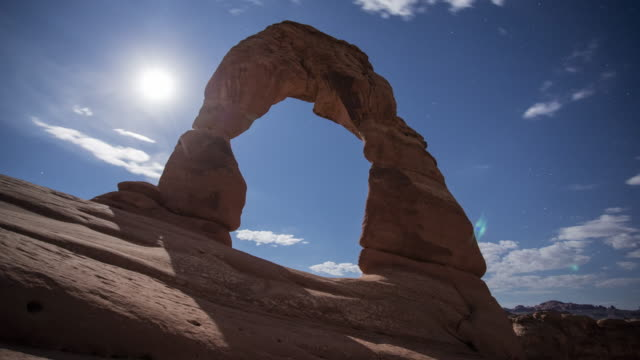 TL View of Delicate Arch with full moon / Moab, USA