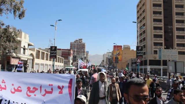 view of demonstrators on the streets of sanaa. they are demonstrating against the immunity law which breaches yemen's obligations under international... - yemen stock videos & royalty-free footage