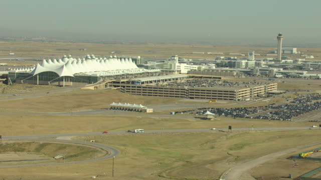 stockvideo's en b-roll-footage met ws aerial view of denver international airport with traffic control tower and runways / denver, colorado, united states - dia