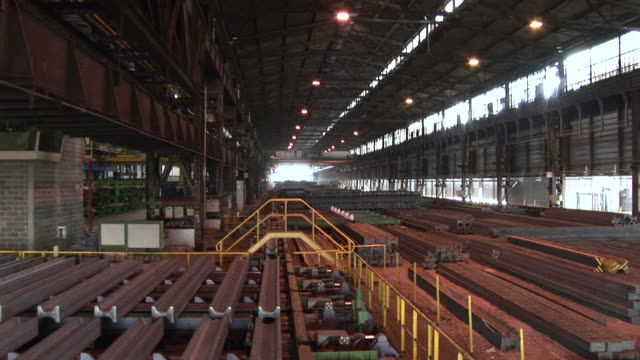 ws view of depot for steel girders at steel mill / esch sur alzette, esch, luxembourg - 桁橋点の映像素材/bロール