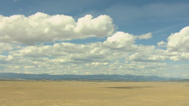 ws aerial view of desert under big sunny open sky with clouds in pueblo county / colorado, united states - pueblo colorado stock videos & royalty-free footage