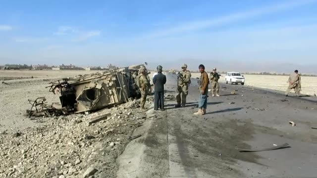 a view of destroyed military vehicle following the first suicide bomb attack on nato forces convoy in reng road region of eastern nangarhar province... - 2001年~ アフガニスタン紛争点の映像素材/bロール