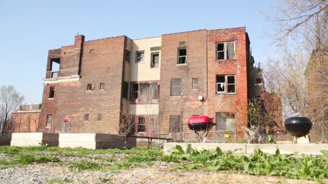 WS View of deteriorating anbandoning building / Detroit, Michigan, United States