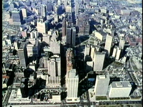 vídeos de stock, filmes e b-roll de aerial, montage, view of detroit, 1960's, michigan, usa - 1960 1969