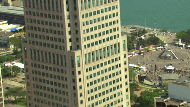 WS AERIAL View of  Detroit International Jazz Festival at Renaissance Center and skyscraper buildings / Detroit, Michigan, United States