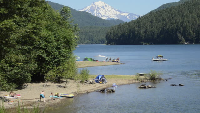 ws view of detroit lake state park and family camping on beach / detroit lake state park, oregon, united states - oregon us state stock videos and b-roll footage