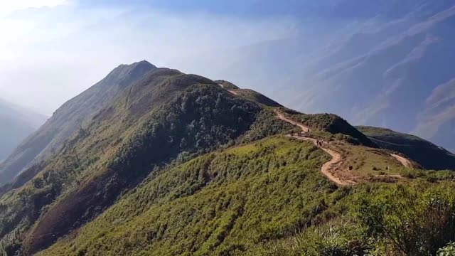 view of dinosaur backbone in foggy at ta xua, bac yen, son la, vietnam. sunrise, mountain hill path road panoramic landscape - bacillus subtilis stock videos & royalty-free footage