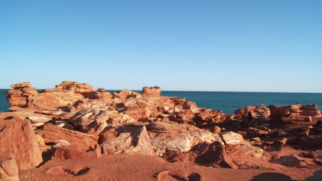 WS TD View of dinosaur footprints with sea in background / Broome, Western Australia, Australia