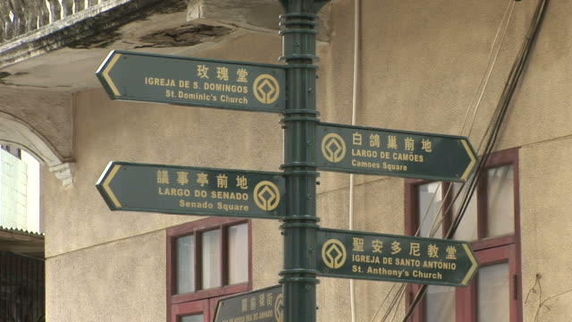 view of direction signboards in macau china - leal senado square stock videos and b-roll footage