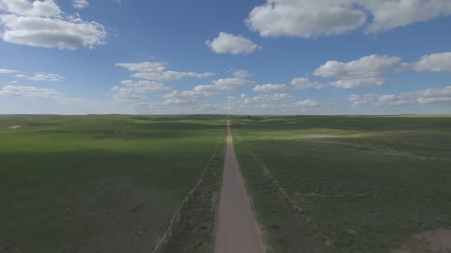 ms aerial tu la view of dirt road to reveal plains west of ash hollow state park / nebraska, united states - 20 seconds or greater stock videos & royalty-free footage