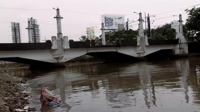 ws view of dirty river / surabaya, east java, indonesia - surabaya stock videos & royalty-free footage