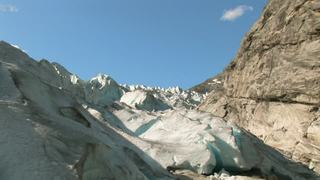 WS ZI View of dirty surface of the glacier beneath mountain / Jostedalbreen National Park, Norway