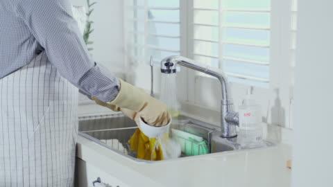 vídeos y material grabado en eventos de stock de view of dishes being washed in the kitchen - clean