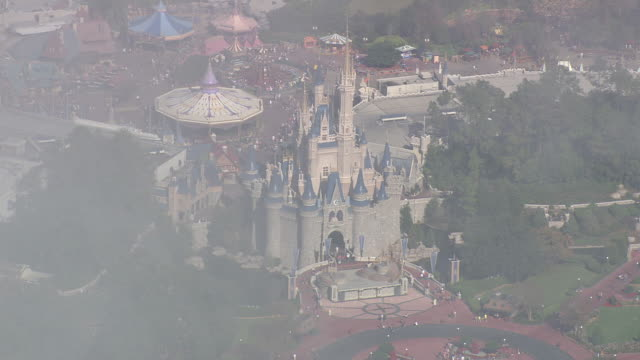 aerial ws view of disney from above clouds / florida, united states - disney stock videos and b-roll footage
