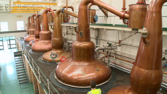 ws view of distillation process in whisky factory / rothes, speyside, scotland - scotland stock videos & royalty-free footage