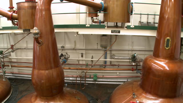 MS PAN View of distillation process in whisky factory / Rothes, Speyside, Scotland