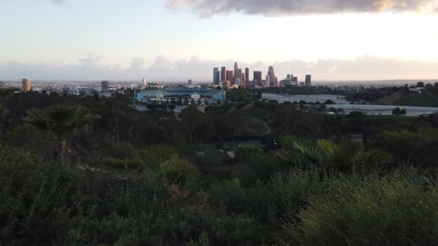 coronavirus pandemic causes climate of anxiety and changing routines los angeles california march 26 view of dodger stadium and downtown la on what... - baseballmannschaft stock-videos und b-roll-filmmaterial