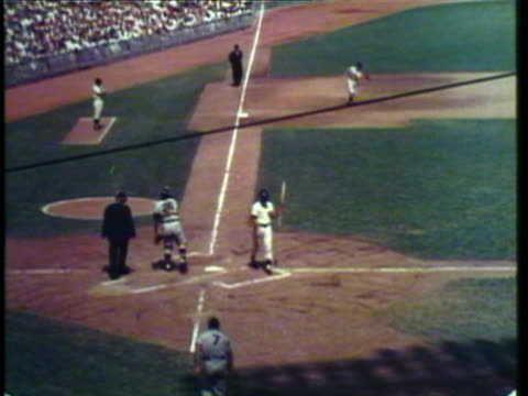 1953 ws pan view of dodger stadium, men playing professional baseball while the crowd cheers / new york city, new york, usa / audio - scoring stock videos & royalty-free footage
