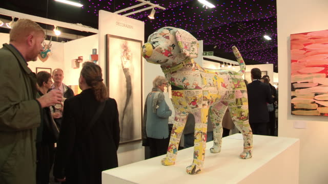 ms view of dog sculpture on display at art exhibition / london, united kingdom - exhibition stock videos & royalty-free footage