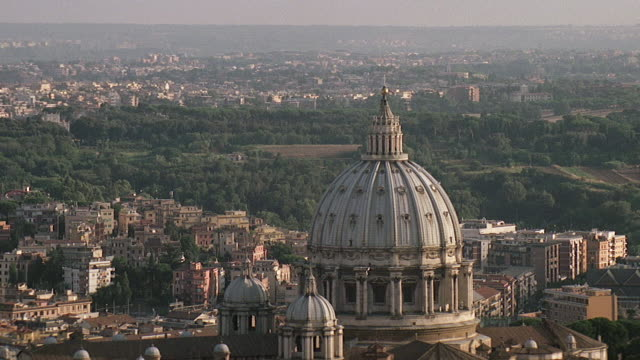 ws aerial ds zo view of dome of st peters basilica / rome, italy - kuppeldach oder kuppel stock-videos und b-roll-filmmaterial
