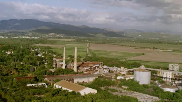 WS AERIAL POV View of Don Q Distillery with Hacienda Mercedita ruins / Ponce, Puerto Rico, United States