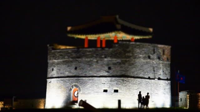 ws t/l view of dongbukgongsimdon building in suwon hwaseong castle at night (unesco) / suwon, gyeonggi-do, south korea - hwaseong palace stock videos and b-roll footage
