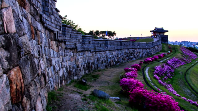 view of dongbukporu bastion and royal azalea of suwon hwaseong castle (unesco world heritage site) at sunset - hwaseong palace stock videos and b-roll footage