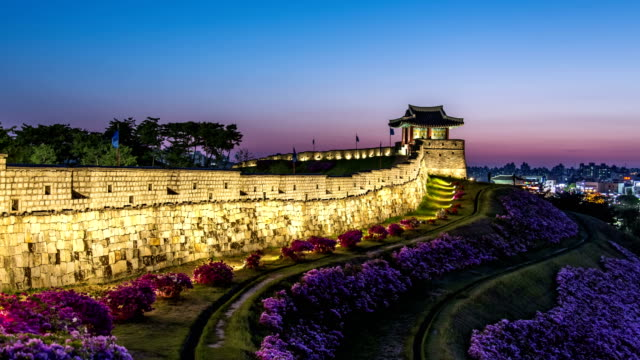view of dongbukporu bastion of suwon hwaseong castle (unesco world heritage site) at night - hwaseong palace stock videos and b-roll footage