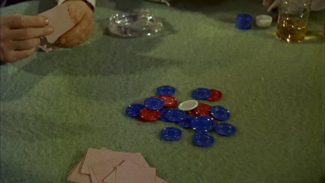 cu view of down poker chips and card on table hands - luck stock videos & royalty-free footage
