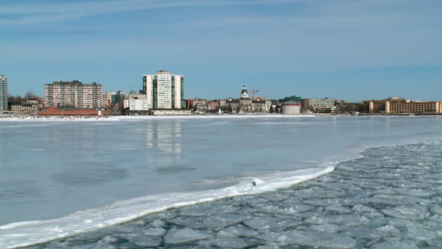 ws pov view of down town from winter ferry / kingston, ontario, canada - ontario canada stock videos & royalty-free footage