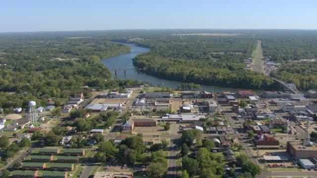 ws aerial view of downtown and edmund pettus bridge over alabama river / selma, alabama, united states - selma alabama stock videos & royalty-free footage