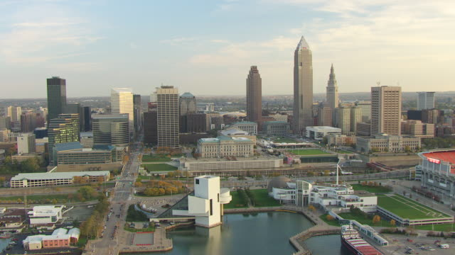 ws td zi aerial view of downtown and rock and roll hall of fame museum building / cleveland, ohio, united states - cleveland ohio stock videos and b-roll footage