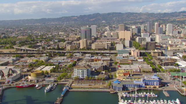WS ZO AERIAL View of downtown and waterfront of Oakland Inner Harbor / Oakland, California, United States